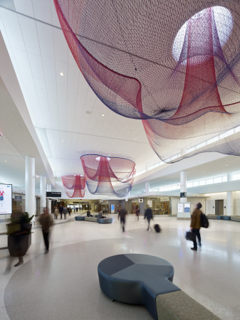 """01 - Janet Echelman's installation """"Every Beating Heart Second"""" in the San Francisco Airport Terminal (photo by Bruce Damonte, All rights reserved)."""